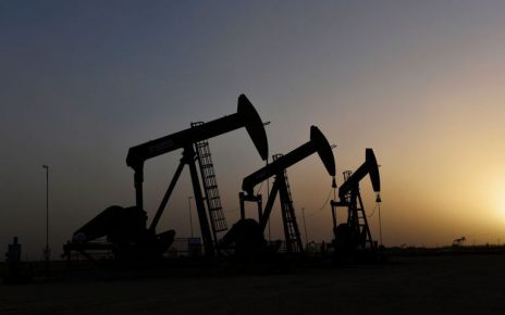 Oil prices hit 11-month high on Saudi cuts, shrugs off US political turmoil