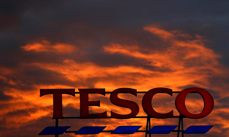 Tesco Falls as Staff Costs Eat up Panic-Buying Gains
